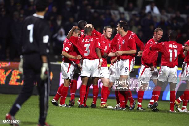 England's Michael Owen celebrates scoring the opening goal against Azerbaijan with Wayne Rooney Ashley Cole and Frank Lampard