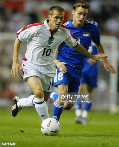 England's Michael Owen challenges Andreas Gerster of Liechtenstein for the ball during their group seven Euro 2004 qualifier at Old Trafford...