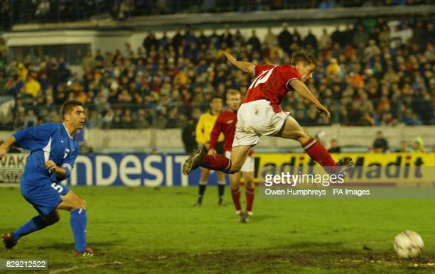 England's Michael Owen scores his first goal during their European Championship Qualifying Group 7 match at the Tehele Pole Stadium in Bratislava in...
