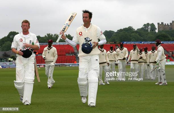 England's Michael Vaughan and Paul Collingwood celebrate following the fifth day of the Fourth npower Test at the County Ground ChesterleStreet Durham