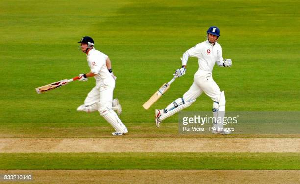 England's Michael Vaughan and Paul Collinwood score runs against India during the fourth day of the Second npower Test match at Trent Bridge...