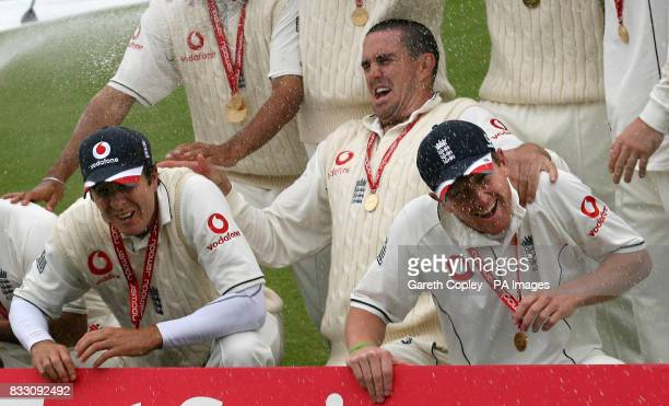 England's Michael Vaughan Kevin Pietersen and Paul Collingwood celebrate following the fifth day of the Fourth npower Test at the County Ground...
