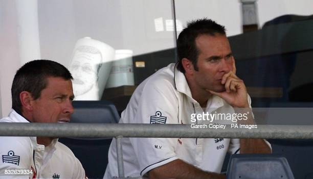 England's Michael Vaughan sits in the stand with Ashley Giles during the second day of the Tour match against Western Australia at WACA Ground Perth...