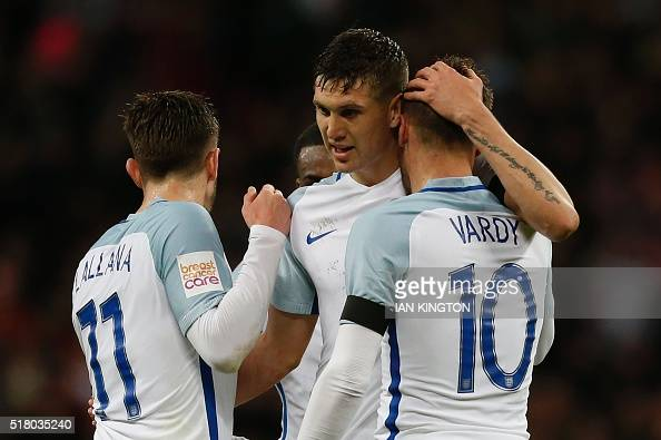 England's midfielder Adam Lallana England's defender John Stones and England's striker Jamie Vardy celebrate after Vardy scored the opening goal...