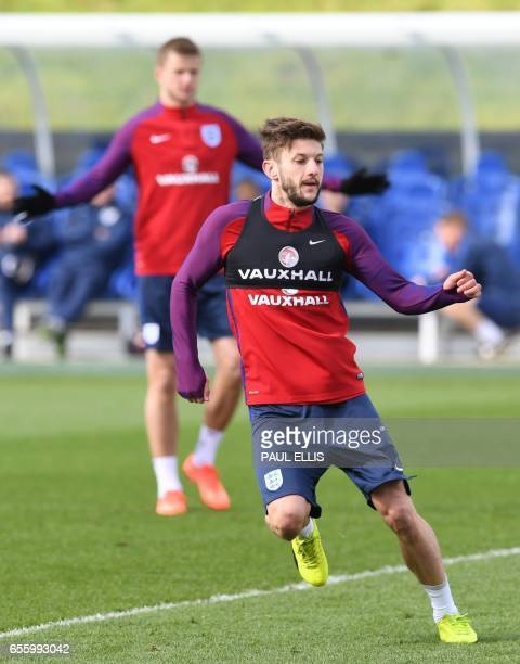 England's midfielder Adam Lallana takes part in a team training session at St George's Park in BurtononTrent on March 21 ahead of their friendly...