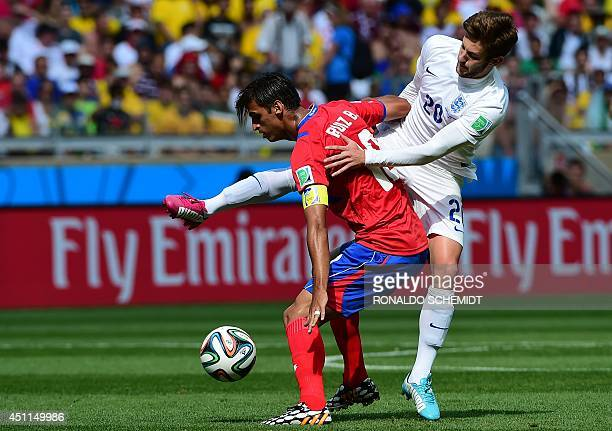 England's midfielder Adam Lallana vies for the ball against Costa Rica's forward Bryan Ruiz during a Group D match between Costa Rica and England at...