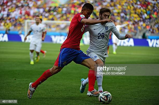 England's midfielder Adam Lallana vies for the ball against Costa Rica's defender Oscar Duarte during a Group D match between Costa Rica and England...