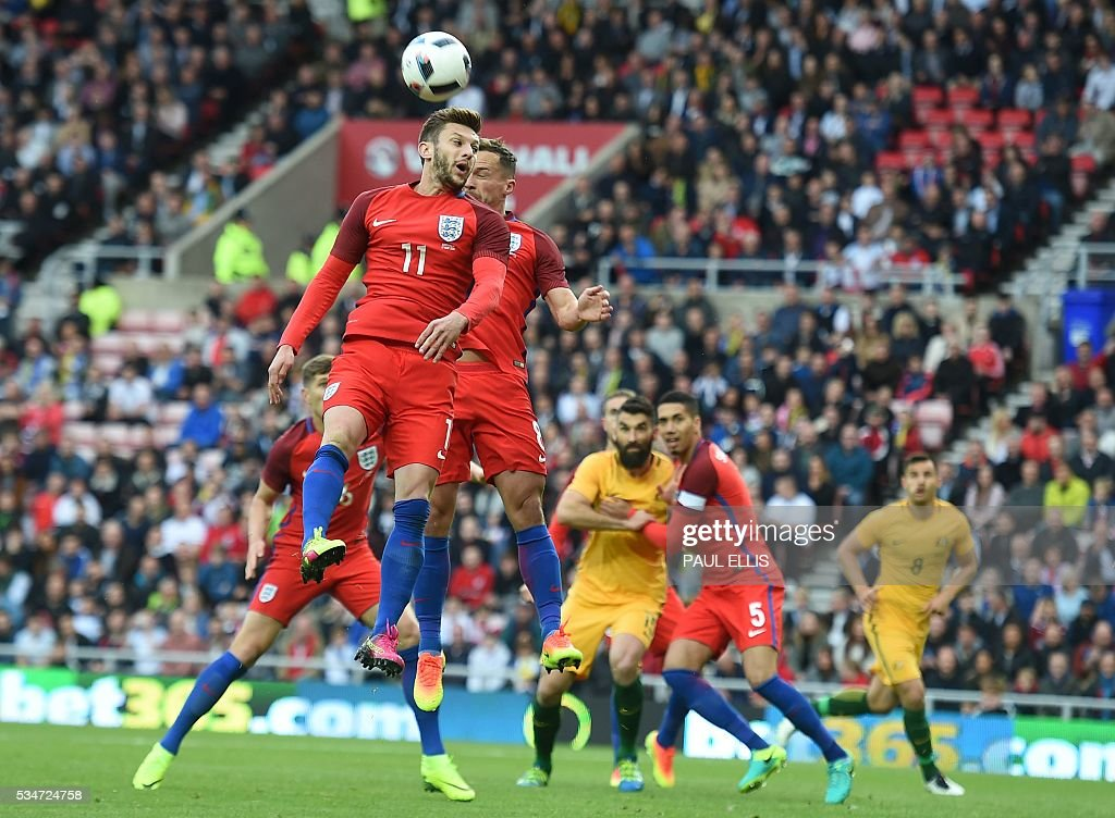 England's midfielder Adam Lallana (Top L) vies for the ball during the friendly football match between England and Australia at the Stadium of Light in Sunderland, north east England, on May 27, 2016. / AFP / PAUL