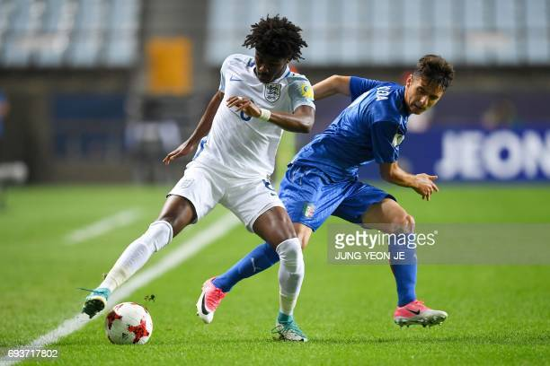 England's midfielder Ainsley MaitlandNiles and Italy's defender Giuseppe Scalera compete for the ball during the U20 World Cup semifinal football...