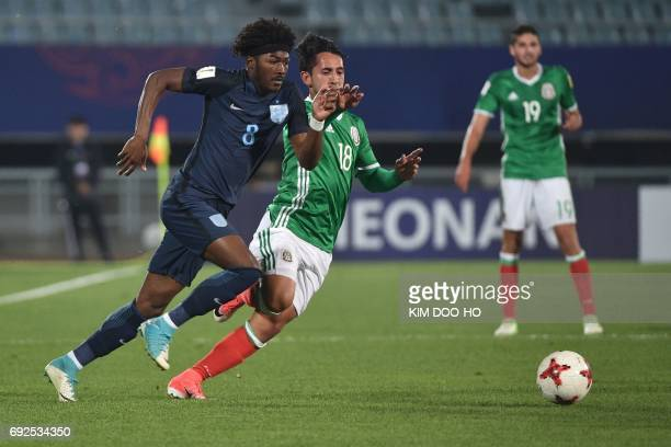 England's midfielder Ainsley MaitlandNiles and Mexico's midfielder Diego Aguilar compete for the ball during the U20 World Cup quarterfinal football...