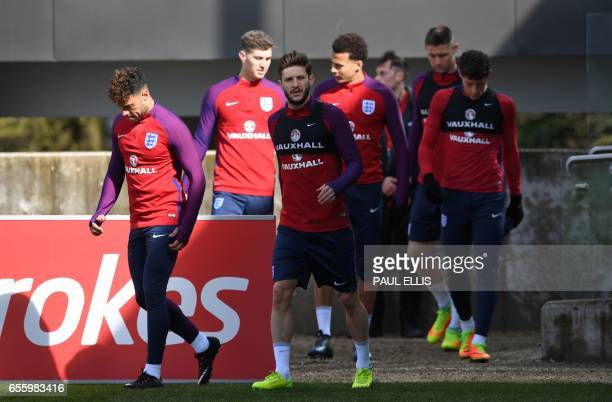England's midfielder Alex OxladeChamberlain and England's midfielder Adam Lallana arrive for a team training session at St George's Park in...