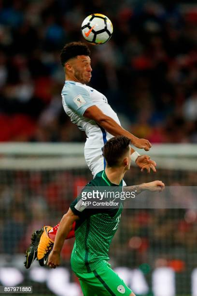 England's midfielder Alex OxladeChamberlain heads the ball during the FIFA World Cup 2018 qualification football match between England and Slovenia...