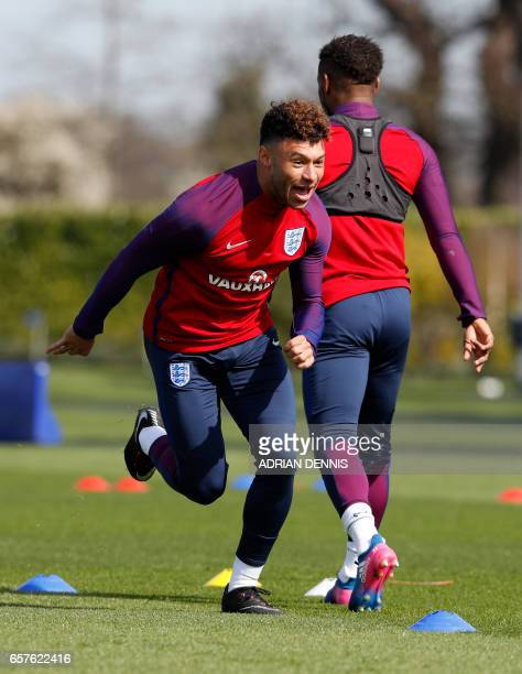 England's midfielder Alex OxladeChamberlain takes part in a training session at Tottenham Hotspur's training complex in Enfield north London on March...