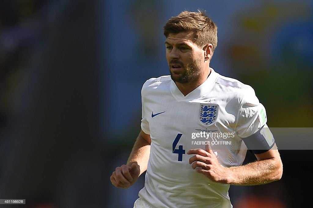 England's midfielder and captain Steven Gerrard runs on the pitch during the Group D football match between Costa Rica and England at The Mineirao...