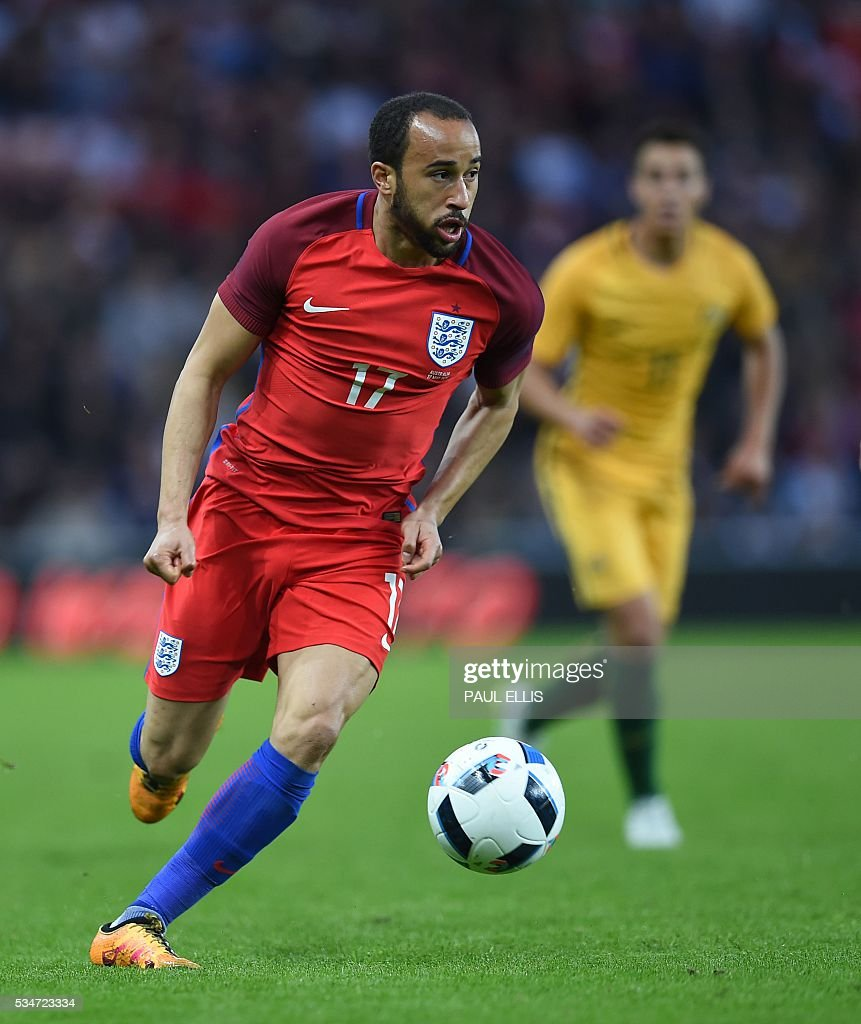 England's midfielder Andros Townsend (L) in action during the friendly football match between England and Australia at the Stadium of Light in Sunderland, north east England, on May 27, 2016. / AFP / PAUL