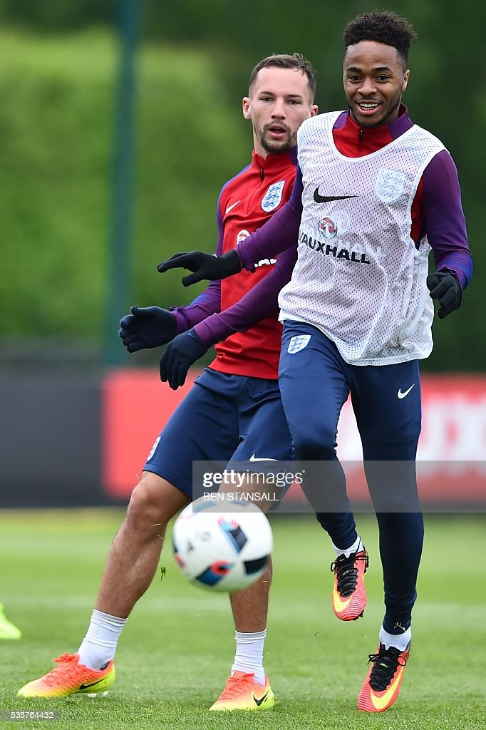 England's midfielder Danny Drinkwater (L) and England's midfielder Raheem Sterling take part in a team training session in Watford, north of London, on May 30, 2016. England play against Portugal in a friendly match at London's Wembley Stadium on Thursday June 2, 2016. / AFP / BEN