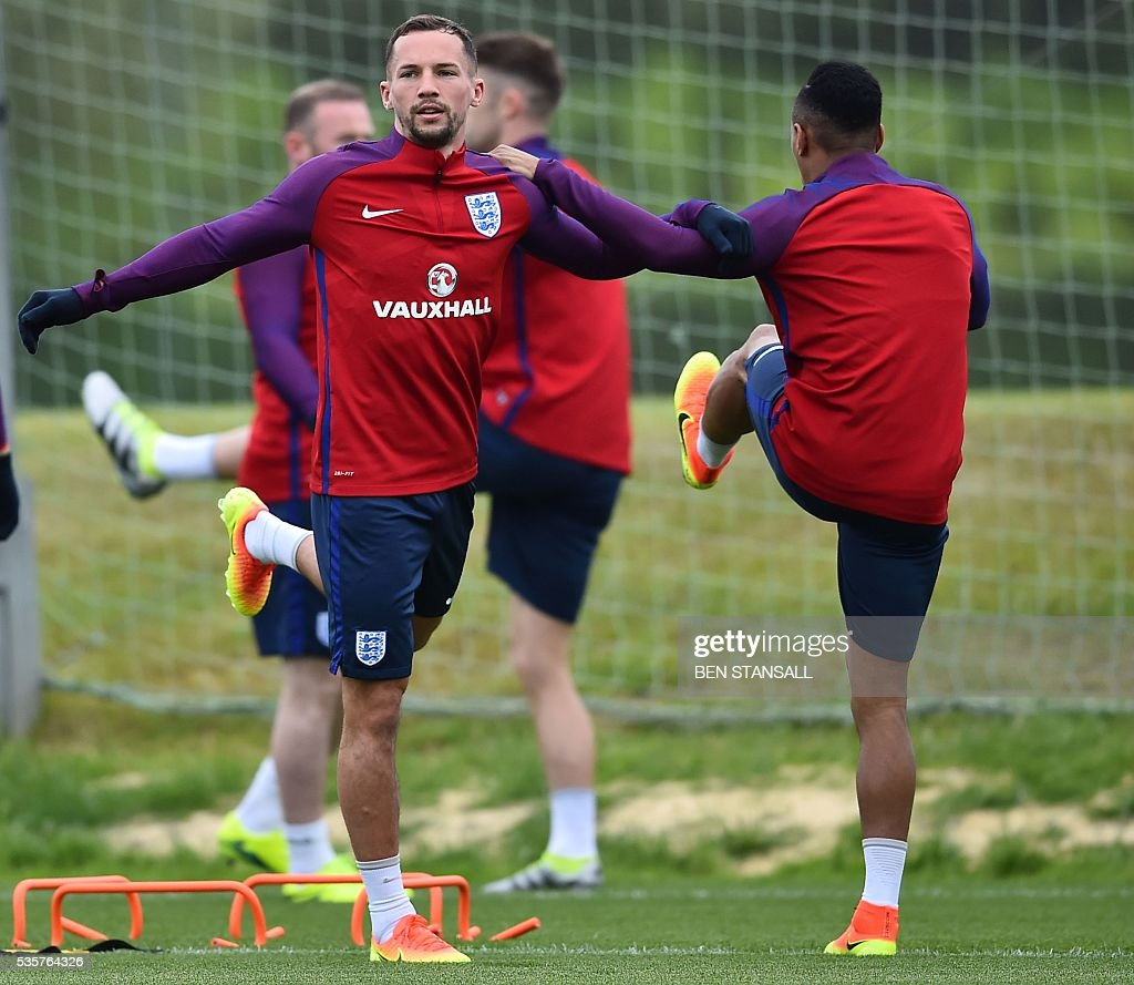 England's midfielder Danny Drinkwater (L) takes part in a team training session in Watford, north of London, on May 30, 2016. England play against Portugal in a friendly match at London's Wembley Stadium on Thursday June 2, 2016. / AFP / BEN