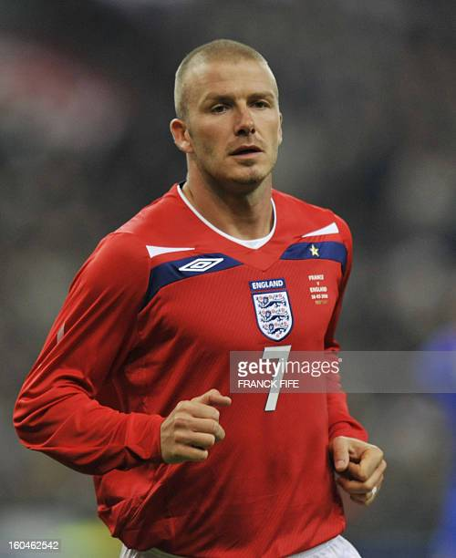 England's midfielder David Beckham runs during their friendly football match against France on March 26 2008 at the Stade de France in SaintDenis...