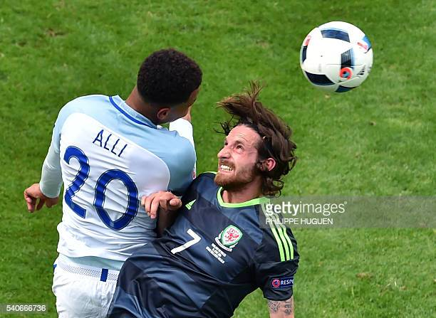England's midfielder Dele Alli and Wales' midfielder Joe Allen vie for the ball during the Euro 2016 group B football match between England and Wales...