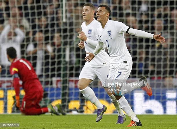 England's midfielder Dele Alli celebrates scoring his team's first goal during the friendly football match between England and France at Wembley...