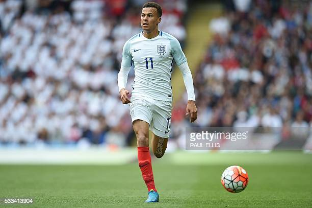 England's midfielder Dele Alli controls the ball during the friendly football match between England and Turkey at the Etihad Stadium in Manchester...