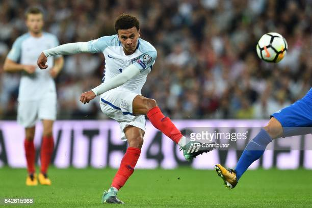 England's midfielder Dele Alli has an unsuccessful shot during the World Cup 2018 qualification football match between England and Slovakia at...
