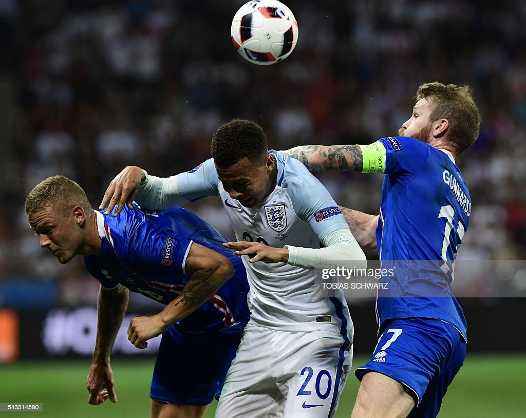 England's midfielder Dele Alli (C) vies for the ball against Iceland's defender Ragnar Sigurdsson (L) and Iceland's midfielder Aron Gunnarsson during Euro 2016 round of 16 football match between England and Iceland at the Allianz Riviera stadium in Nice on June 27, 2016. / AFP / TOBIAS