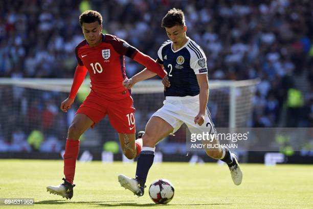 England's midfielder Dele Alli vies with Scotland's defender Kieran Tierney during the group F World Cup qualifying football match between Scotland...