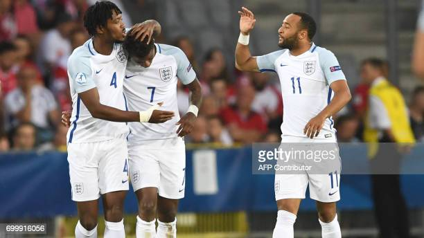 England's midfielder Demaray Grey celebrate scoring the opening goal with his teamate Nathaniel Chalobach and Nathan Redmond during the UEFA U21...