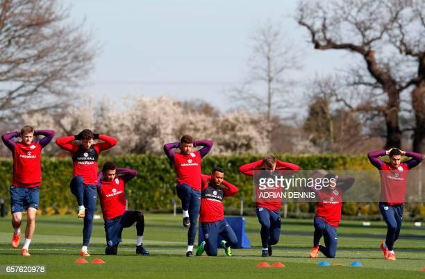 England's midfielder Eric Dier England's midfielder Ross Barkley England's midfielder Dele Alli England's midfielder Alex OxladeChamberlain England's...