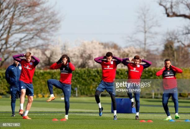 England's midfielder Eric Dier England's midfielder Ross Barkley England's midfielder Dele Alli England's midfielder Alex OxladeChamberlain and...