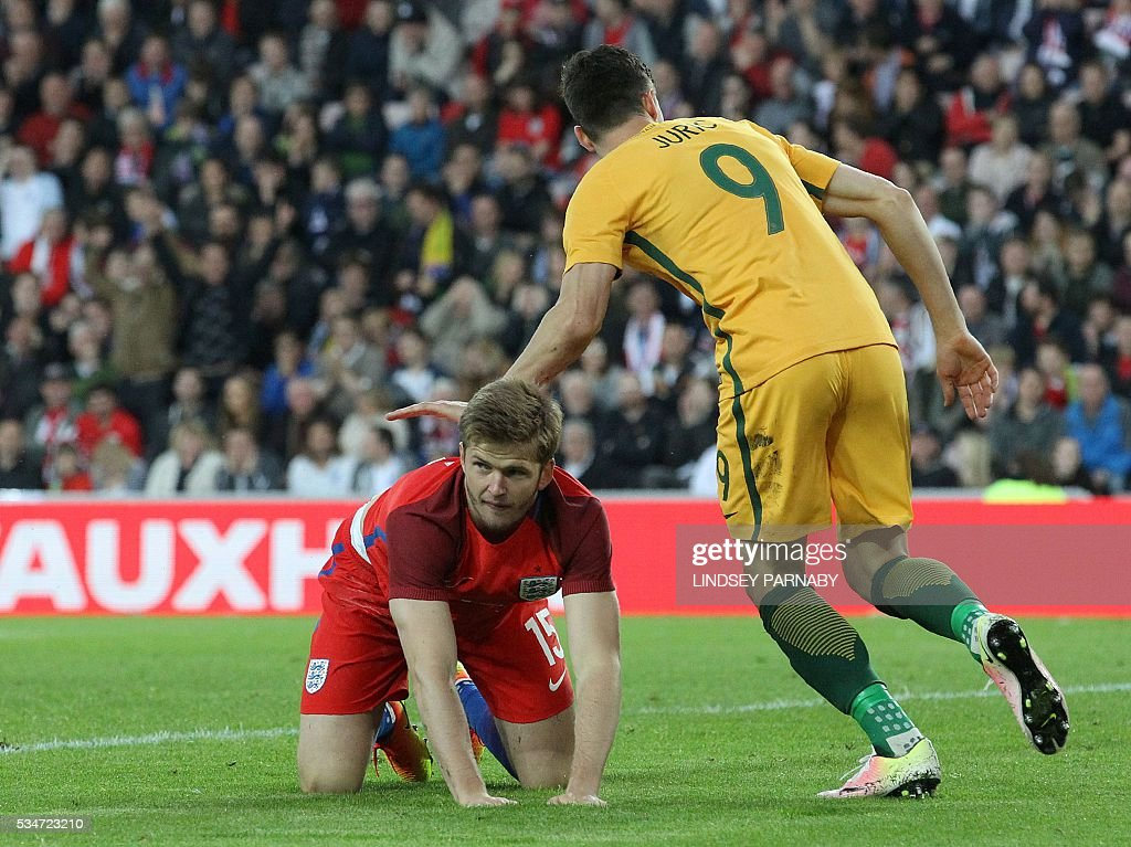 England's midfielder Eric Dier (Below) reacts after scoring an own goal during the friendly football match between England and Australia at the Stadium of Light in Sunderland, north east England, on May 27, 2016. / AFP / Lindsey PARNABY / NOT