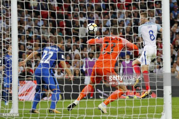 England's midfielder Eric Dier shoots past Slovakia's goalkeeper Martin Dubravka to score England's equalizer during the World Cup 2018 qualification...
