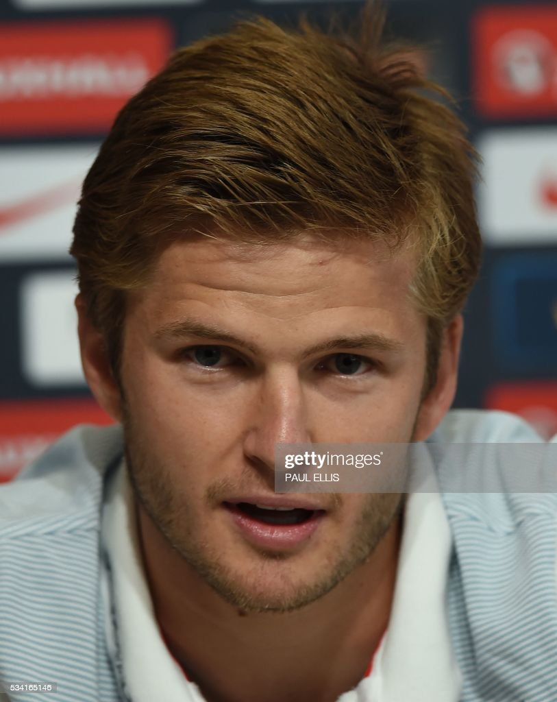 England's midfielder Eric Dier speaks during a press conference at the City Football Academy in Manchester, north-west England, on May 25, 2016. England are set to play Australia in a friendly international football match in Sunderland on May 27, 2016. / AFP / PAUL