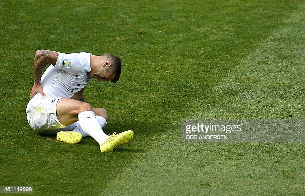 England's midfielder Jack Wilshere reacts during the Group D football match between Costa Rica and England at The Mineirao Stadium in Belo Horizonte...