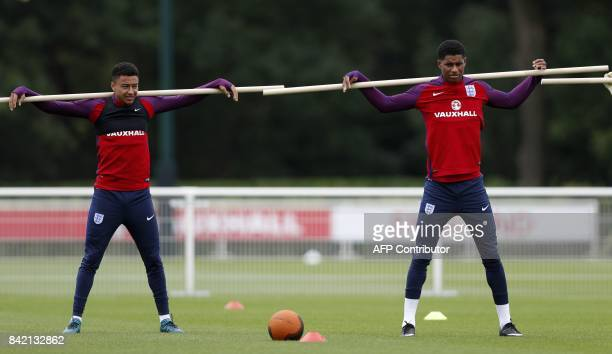 England's midfielder Jesse Lingard and England's striker Marcus Rashford take part in an England team training session at Tottenham Hotspur's...