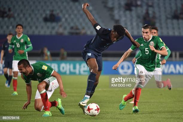 England's midfielder Joshua Onomah controls the ball during the U20 World Cup quarterfinal football match between England and Mexico in Cheonan on...