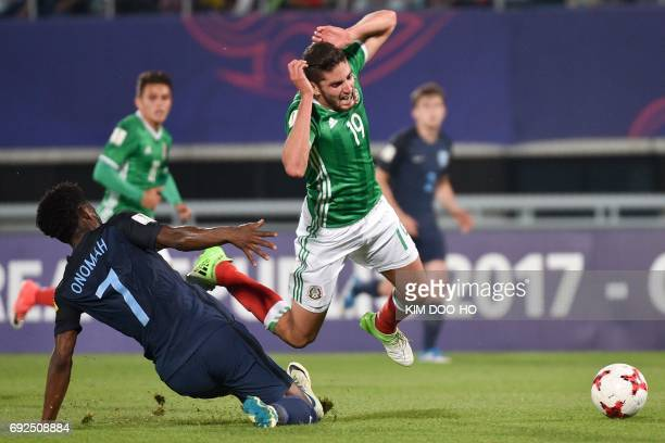 England's midfielder Joshua Onomah tackles Mexico's forward Paolo Yrizar during the U20 World Cup quarterfinal football match between England and...