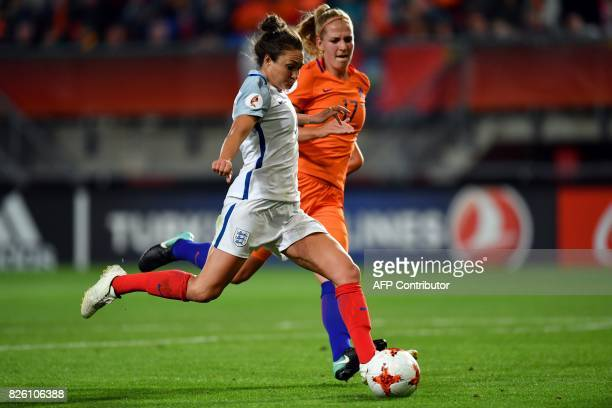 England's midfielder Karen Carney vies for the ball with Netherlands' defender Kelly Zeeman during the UEFA Womens Euro 2017 football tournament...