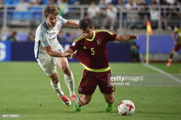 England's midfielder Kieran Dowell and Venezuela's defender Jose Hernandez during the U20 World Cup final football match between England and...