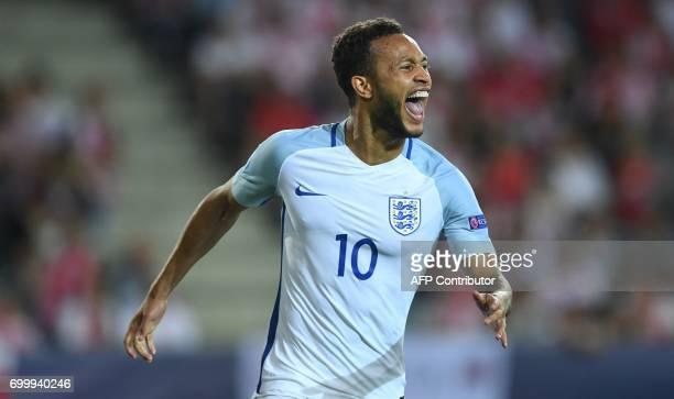 England's midfielder Lewis Baker celebtates scoring a penalty during the UEFA U21 European Championship Group A football match England v Poland in...