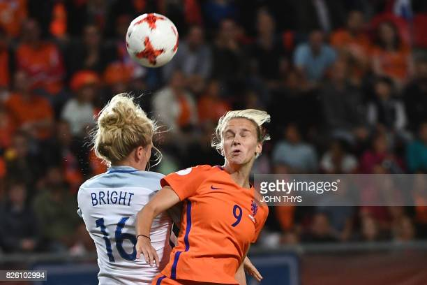 TOPSHOT England's midfielder Millie Bright jumps for the ball Netherlands' forward Vivianne Miedema during the UEFA Womens Euro 2017 football...