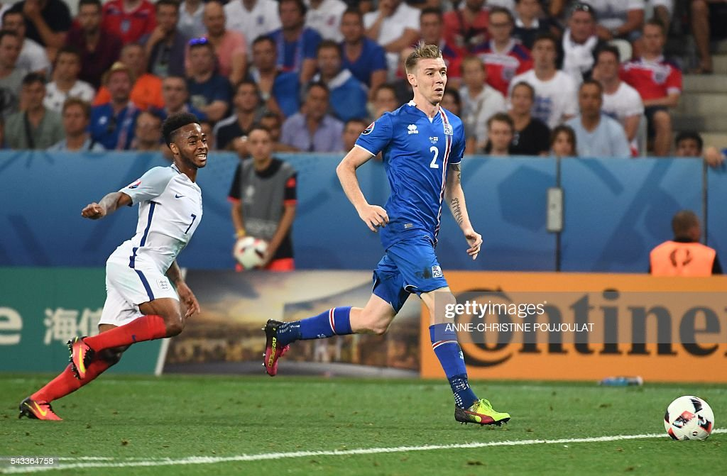England's midfielder Raheem Sterling (L) and Iceland's defender Birkir Saevarsson (R) vie for the ball during Euro 2016 round of 16 football match between England and Iceland at the Allianz Riviera stadium in Nice on June 27, 2016. / AFP / ANNE