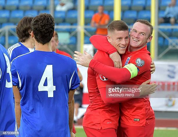 England's midfielder Ross Barkley celebrates with England's forward Wayne Rooney after soring during the EURO 2016 qualifying football match San...