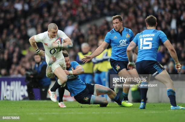 England's Mike Brown is tackled by Italy's Michele Campagnaro during the RBS Six Nations Championship match between England and Italy at Twickenham...