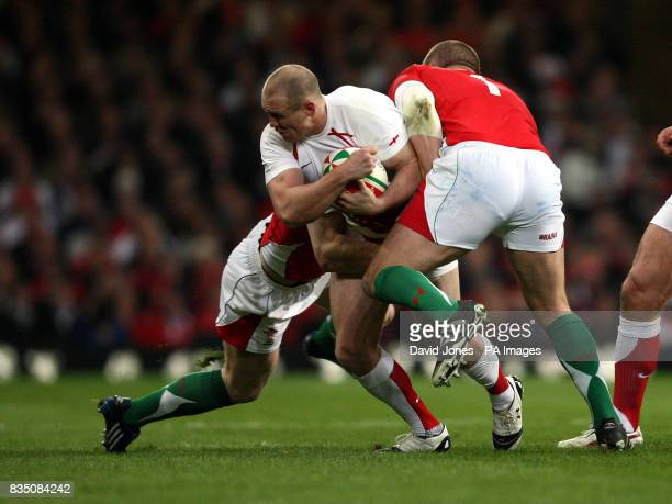 England's Mike Tindall is caught by Wales' Gethin Jenkins and Mark Jones during the RBS 6 Nations match at the Millennium Stadium Cardiff