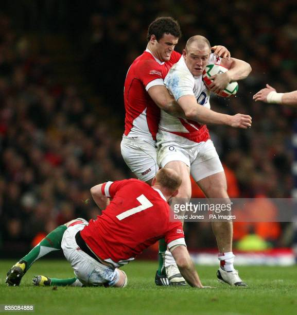 England's Mike Tindall is caught by Wales' Jamie Roberts during the RBS 6 Nations match at the Millennium Stadium Cardiff