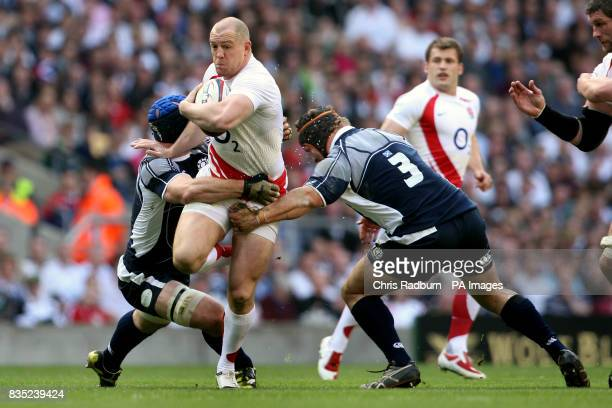 England's Mike Tindall is challenged by Scotland's Alasdair Strokosch and Euan Murray during the RBS Six Nations match at Twickenham London