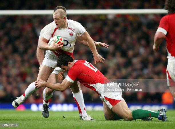 England's Mike Tindall is tackled by Wales Jamie Roberts during the RBS 6 Nations match at the Millennium Stadium Cardiff