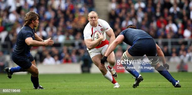 England's Mike Tindall takes on France's Dimitri Szarzewski and Jerome Thion during the RBS 6 Nations match at Twickenham London
